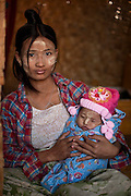 A young mother with her baby, in Inle Lake, Myanmar.<br /> Note: These images are not distributed or sold in Portugal