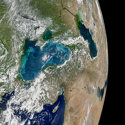 Jun 12, 2017 - Space - Most summers, jewel-toned hues appear in the Black Sea. The turquoise swirls are not the brushstrokes of a painting; they indicate the presence of phytoplankton, which trace the flow of water currents and eddies. On May 29, 2017, the Moderate Resolution Imaging Spectroradiometer (MODIS) on NASA's Aqua satellite captured the data for this image of an ongoing phytoplankton bloom in the Black Sea. The image is a mosaic, composed from multiple satellite passes over the region. Phytoplankton are floating, microscopic organisms that make their own food from sunlight and dissolved nutrients. Here, ample water flow from rivers like the Danube and Dnieper carries nutrients to the Black Sea. In general, phytoplankton support fish, shellfish, and other marine organisms. But large, frequent blooms can lead to eutrophication, the loss of oxygen from the water and end up suffocating marine life. One type of phytoplankton commonly found in the Black Sea are coccolithophores, microscopic plankton that are plated with white calcium carbonate. When aggregated in large numbers, these reflective plates are easily visible from space as bright, milky water. (Credit Image: © Norman Kuring/NASA via ZUMA Wire/ZUMAPRESS.com)