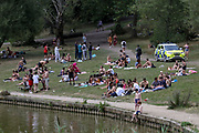 Hampstead Heath Constabulary policing patrol observe a large gathering of the British people who gathered to enjoy the hot weather in Hampstead Heath Park in northwest London on Friday, Aug 7, 2020. <br /> Exceptionally hot weather is set to continue in parts of the UK throughout the weekend, the Met Office said. The highest temperatures are expected in England and Wales, with a fresher weather forecast for Scotland and NI. The UK has seen its hottest day in August for 17 years, as temperatures reached more than 36C (96.8F) in south-east England, British press reports. (VXP Photo/ Vudi Xhymshiti)