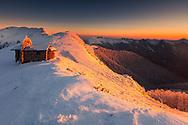 Small stone chapel in the mountain ridge