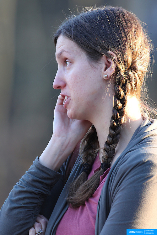 A distraught women crying as she leaves the fire station in Sandy Hook after today's shootings at Sandy Hook Elementary School, Newtown, Connecticut, USA. 14th December 2012. Photo Tim Clayton