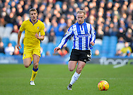 Sheffield Wednesday Midfielder Barry Bannan races ahead of Leeds United Defender Scott Wootton during the Sky Bet Championship match between Sheffield Wednesday and Leeds United at Hillsborough, Sheffield, England on 16 January 2016. Photo by Adam Rivers.