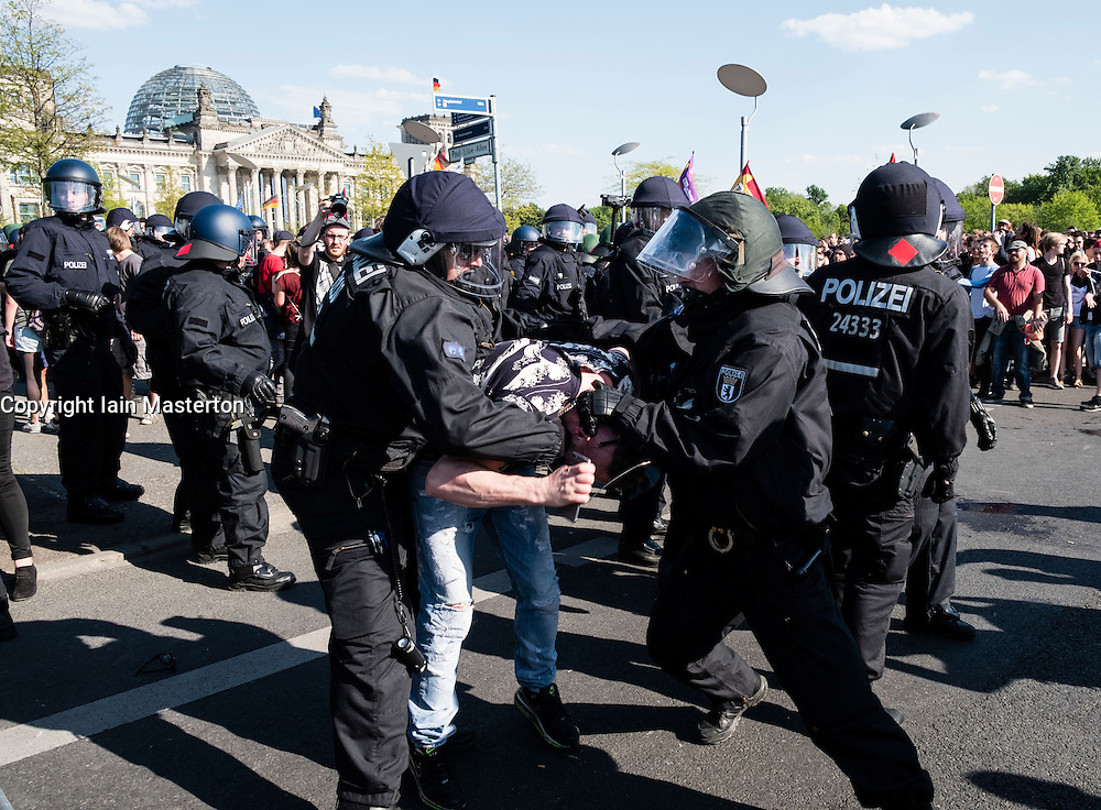 Berlin, Germany. 7th May 2016. Pro-Refugee demonstrator is arrested following scuffles with riot police near The Reichstag in Berlin. Far-right protesters were demonstrating against islam, refugees and Angela Merkel in Mitte Berlin. Protestors demanded that Chancellor Angela Merkel stand down because of allowing large numbers of refugees and migrants to enter Germany.