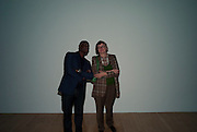 EKOW ESHUN; PHILLIPA PERRY, Private view for the Turner prize exhibition. Tate Britain. London. 4 October 2010. -DO NOT ARCHIVE-© Copyright Photograph by Dafydd Jones. 248 Clapham Rd. London SW9 0PZ. Tel 0207 820 0771. www.dafjones.com.