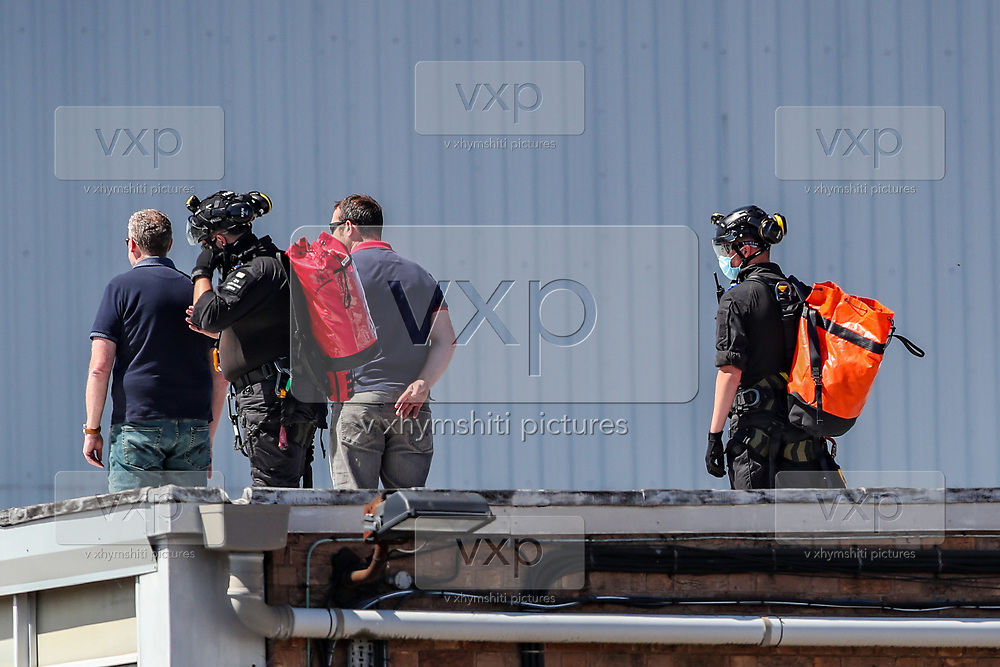 """Birmingham, United Kingdom, June 15, 2021: Protestor Removal Unit of the British police have removed and arrested Palestine Action activists who occupied Arconic factory site building in Birmingham on Tuesday, June 15, 2021. Activists occupied the admin office building on Monday morning, marking 4th anniversary of Grenfell Tower fire in london arguing that """"... it was Arconic who produced flamable cladding for Grenfell where over 70 people died for years ago."""" Activists also said that Arconic does provide  'materials for Israel's fighter jets.' (VX Photo/ Vudi Xhymshiti)"""