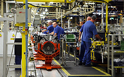 """File photo dated 25/06/10 of engineers working at an car engine plant. Investment decisions on 15 new car models in the UK are """"hanging by a thread"""" as industry waits for the outcome of Brexit negotiations, a report warns."""