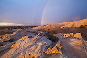 Rainbows at sunrise over the sandstone formations of the San Rafael Swell, Utah.