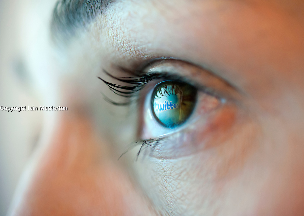 Reflection from Twitter social messaging  website reflected in woman's eye