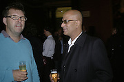 JAMIE ROBINSON AND AZHAR, Owning Art- The Contemporary Art Collectors Handbook by Judith Greer and Louisa Buck. National Gallery. London. 2 October 2006. -DO NOT ARCHIVE-© Copyright Photograph by Dafydd Jones 66 Stockwell Park Rd. London SW9 0DA Tel 020 7733 0108 www.dafjones.com