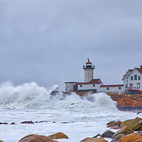 New England photography of Eastern Point Lighthouse where waves pounding and smashing into one of Massachusetts historic lighthouses. This beautiful Massachusetts lighthouse is located in Gloucester on Cape Ann.<br /> <br /> New England lighthouse photography images are available as museum quality photo, canvas, acrylic, wood or metal prints. Wall art prints may be framed and matted to the individual liking and interior design decoration needs:<br /> <br /> https://juergen-roth.pixels.com/featured/winterstorm-waves-at-astern-point-lighthouse-juergen-roth.html<br /> <br /> Good light and happy photo making!<br /> <br /> My best,<br /> <br /> Juergen