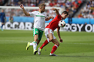 Ben Davies  of Wales ® is challenged by Jamie Ward of Northern Ireland.UEFA Euro 2016, last 16 , Wales v Northern Ireland at the Parc des Princes in Paris, France on Saturday 25th June 2016, pic by  Andrew Orchard, Andrew Orchard sports photography.