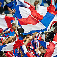 05 September 2009: Supporters hold French flags during the World Cup 2010 qualifying football match France vs. Romania (1-1), on September 5, 2009 at the Stade de France stadium in Saint-Denis, near Paris, France.