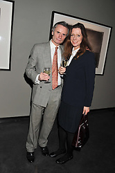 BARRY JOHN NICHOLLS and LINDSEY ANNABEL at a private view of photographs by Christopher Thomas entit;ed 'Venice in Solitude' held at Hamiltons, 13 Carlos Place, London on 31st January 2012.