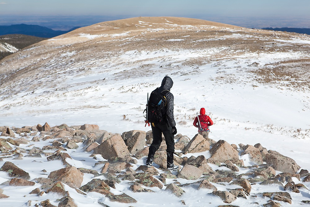 Obadiah Reid and Grace Marx hike down a broad ridge below Pawnee Peak, Indian Peaks Wilderness, Rocky Mountains, Colorado.