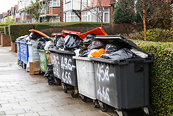 London, December 31 2017. Rubbish and old clothes mount up at some recycling sites in London, with others appearing to have had their contents recently collected. PICTURED: Overflowing bins in Golders Green. © SWNS