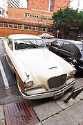 A Studebaker Silver Hawk Classic Car parked on a street, painted in cream white and brown, ca 1950s 50s 1950 50 Buenos Aires Argentina, South America