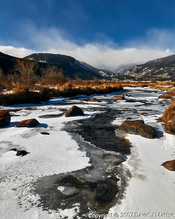 Snow and Ice covered stream in Rocky Mountain National Park. Image taken with a Nikon D300 camera and 17-35 mm f/2.8 lens (ISO 200, 19 mm, f/22, 1/40 sec).