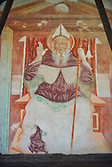 Religious mural of Saint Antonio Abate an a throne above with the canonical symbols of a bell and piglet, above the main portal, Sined by Cristoforo I Baschenis, 1474, on the exterior of the Gothic Church of San Antonio Abate,  Pelugo, Province of Trento, Italy .<br /> <br /> Visit our ITALY PHOTO COLLECTION for more   photos of Italy to download or buy as prints https://funkystock.photoshelter.com/gallery-collection/2b-Pictures-Images-of-Italy-Photos-of-Italian-Historic-Landmark-Sites/C0000qxA2zGFjd_k<br /> If you prefer to buy from our ALAMY PHOTO LIBRARY  Collection visit : https://www.alamy.com/portfolio/paul-williams-funkystock/san-antonio-abate-pelugo.html