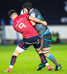 Morgan Morris of Ospreys under pressure from Connor Murray of Munster <br /> <br /> Photographer Simon King/Replay Images<br /> <br /> European Rugby Champions Cup Round 1 - Ospreys v Munster - Saturday 16th November 2019 - Liberty Stadium - Swansea<br /> <br /> World Copyright © Replay Images . All rights reserved. info@replayimages.co.uk - http://replayimages.co.uk