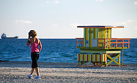 Young woman working out early morning in Miami Beach