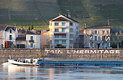town of tain key side and barge tain l hermitage rhone france