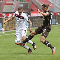 nph00001  17.05.2020 --- Fussball --- Saison 2019 2020 --- 2. Fussball - Bundesliga --- 26. Spieltag: FC Sankt Pauli - 1. FC Nürnberg ---  DFL regulations prohibit any use of photographs as image sequences and/or quasi-video - Only for editorial use ! --- <br /> <br /> Adam Zrelak (11, 1. FC Nürnberg ) Daniel Buballa (15, FC St. Pauli ) <br /> <br /> Foto: Daniel Marr/Zink/Pool//via Kokenge/nordphoto