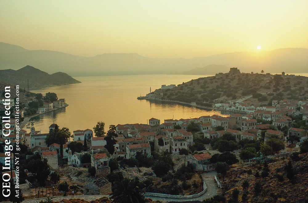 Many houses on a once-thriving island near Turkish coast stand vacant.