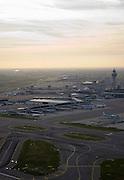 Nederland, Haarlemmermeer, Schiphol, 15-02-2007;  Schiphol airport, zicht op stationsgebouw (terminal) van de luchthaven met verkeerstoren, verbonden met het gebouw de 'slurfen'; verder in beeld de taxibanen (verbindingen met de eigenlijke start- en landingsbanen; slot, geluidsoverlast, profiel, geluidscontour, hinderwet, vliegen, toerisme, verkeersleiding, infrastuctuur, verkeer en vervoer, start, landing.luchtfoto (toeslag); aerial photo (additional fee required); .foto Siebe Swart / photo Siebe Swart