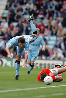 Photo. Leigh Quinnell.  Coventry City v Rotherham United Coca Cola championship. 18/09/2004.<br /> Stephen Hughs takes a tumble with Rotherhams Phil Gilchrist