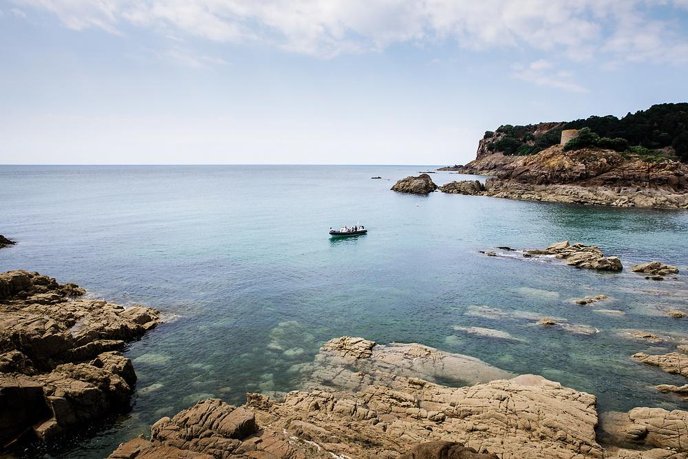 People enjoying a boat excursion near Portelet beach in Jersey, Channel Islands