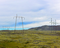 Four Types of High-Tension Power Line Towers Bringing Power from a Geothermal plant to Reykjavik in Iceland. Image taken with a Nikon 1 V2 camera and 18.5 mm f/1.8 lens (ISO 400, 18.5 mm, f/3.5, 1/2000 sec) from the back seat of moving bus. Image sharpened with the new 64-bit version of Focus Magic. Nikonians Academy Photo Adventure Tour in Iceland.