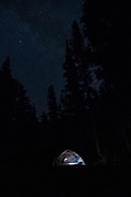 Woman in tent under the stars, Toiyabe National Forest, California
