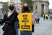 Protesters with an anti-Sun newspaper placard at Extinction Rebellion gather for a citizens assembly on 5th September 2020 in London, United Kingdom. On this day Extinction Rebellion protesters blocked a newspaper printing sites, stopping some Rupert Murdoch newspapers being available on the news stands. With government resitting after summer recess, the climate action group has organised two weeks of events, protest and disruption across the capital. Extinction Rebellion is a climate change group started in 2018 and has gained a huge following of people committed to peaceful protests. These protests are highlighting that the government is not doing enough to avoid catastrophic climate change and to demand the government take radical action to save the planet.