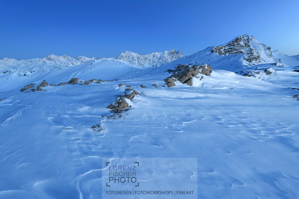 Piz d'Err, Piz Calderas, Piz Arblatsch, Piz Forbesch and Mount Surcarungas at dusk, Savognin, Parc Ela, Grisons, Switzerland