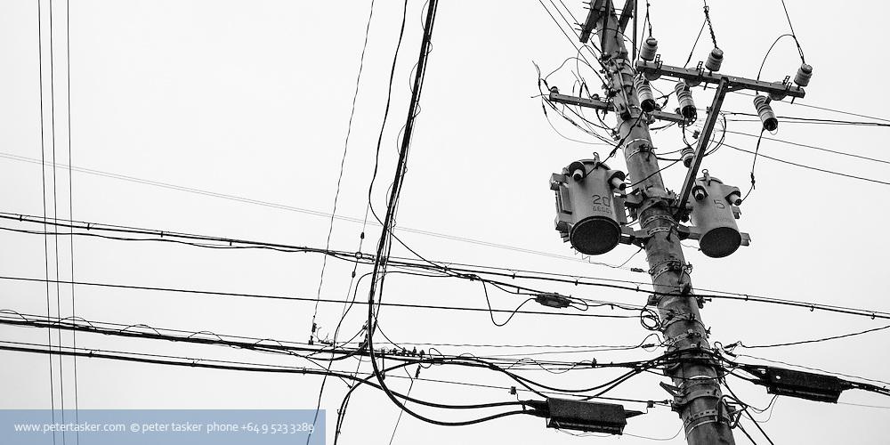Array of power lines and power pole attachments. Naha, Okinawa, Japan.