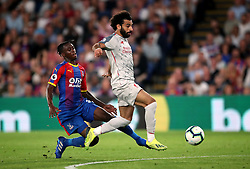 Crystal Palace's Aaron Wan-Bissaka brings down Liverpool's Mohamed Salah before being shown a red card during the Premier League match at Selhurst Park, London.
