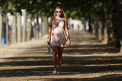 © Licensed to London News Pictures. 24/06/2020. London, UK. A woman makes her way to work in early morning sunshine on The Mall in central London. High temperatures and sunshine are expected in most of the UK over the next few days. Photo credit: Peter Macdiarmid/LNP