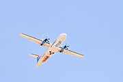 Israel, Ben-Gurion international Airport Arkia Airlines Dash 7 passengers Propellor aeroplane after takeoff