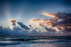 beautiful sunrise through clouds over the ocean in Florida