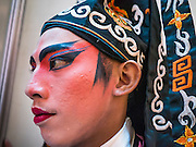 08 FEBRUARY 2013 - BANGKOK, THAILAND: A Chinese opera performer before performing a Chinese opera for Chinese New Year at Seacon Square in Bangkok. Chinese opera is popular in Thailand and is usually performed in the Teochew language. The weeks surrounding Chinese New Year are important for retailers in Thailand and many malls put on special promotions and events honoring Chinese culture, like Lion Dances or Chinese Opera. Thailand has a large Thai-Chinese population. Millions of Chinese emigrated to Thailand (then Siam) in the 18th and 19th centuries and brought their cultural practices with them.    PHOTO BY JACK KURTZ