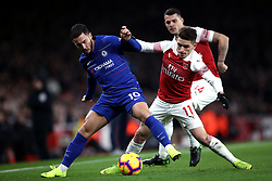 Chelsea's Eden Hazard (left) and Arsenal's Lucas Torreira battle for the ball during the Premier League match at The Emirates Stadium, London.