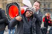 A man shouts through a traffic cone held up by a fellow protester on Westminster Bridge 7th October, 2019 in London, Untited Kingdom. Extinction Rebellion plan to occupy 12 sites situated around key Government locations around Westminster for two weeks to protest against climate change.