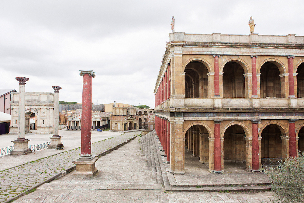 """ROME, ITALY - 30 MARCH 2015: The set of """"Rome"""", the British-American-Italian broadcasted between 2005 and 2007 on HBO, BBC Two and RaiDue, is here in Cinecittà in Rome, Italy, on March 30th 2015.<br /> <br /> Italy instated a special 25% tax credit for film productions in 2010. The industry then lobbied to remove the credit's cap, and last July, Italy lifted its tax credit limit from €5 million per movie to €10 million per company per year. <br />  <br /> Cinecittà, a large film studio in Rome, is considered the hub of Italian cinema. The studios were founded in 1937 by Benito Mussolini as part of a scheme to revive the Italian film industry. In the 1950s, the number of international productions being made here led to Rome being dubbed as the """"Hollywood on the Tiber"""". In the 1950s, Cinecittà was the filming location for several large American film productions like Ben-Hur, and then became the studio most closely associated with Federico Fellini.<br /> After a period of near-bankruptcy, the Italian Government privatized Cinecittà in 1997, selling an 80% stake.<br /> <br /> Currently Ben-Hur and Zoolander 2 are booked into Cinecittà Studios."""