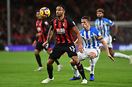 Callum Wilson (13) of AFC Bournemouth and Huddersfield Town defender Tommy Smith (2) during the Premier League match between Bournemouth and Huddersfield Town at the Vitality Stadium, Bournemouth, England on 4 December 2018.
