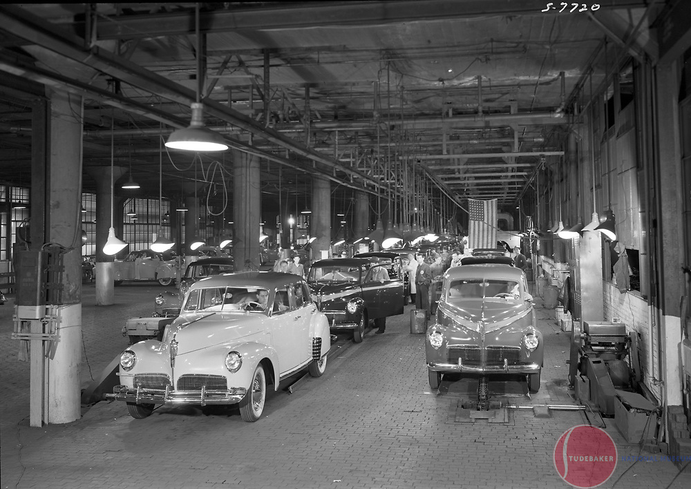A 1941 President Skyway Land Cruiser (l) and a Champion reach the end Studebaker's assembly line.