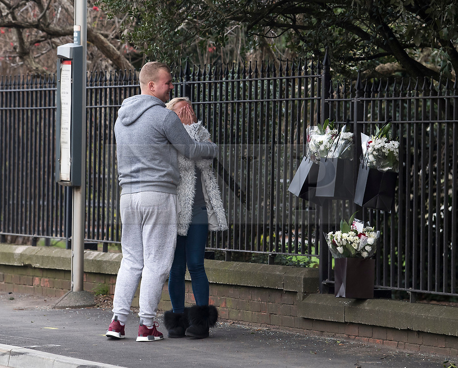 © Licensed to London News Pictures. 27/01/2018. London, UK. Grieving relatives and friends leave flowers at the scene where three teenage pedestrians were killed near a bus stop in Hayes, West London after a black Audi car is believed to have collided with them. Police were called to the incident, on Friday night at 20:41hrs, close to the M4 Junction 4 following reports of a serious road traffic collision. The victims died at the scene - are all believed to be teenage males, aged approximately 16. Photo credit: Ben Cawthra/LNP