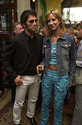 Lady Victoria Hervey and Andreas Siegsfried. Shanghai Tang opening. Sloane St. 11 April 2001. © Copyright Photograph by Dafydd Jones 66 Stockwell Park Rd. London SW9 0DA Tel 020 7733 0108 www.dafjones.com