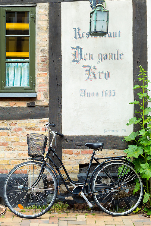 Traditional bicycle at restaurant Den Gamle Kro 17th Century in Nedergade in Odense on Funen Island, Denmark