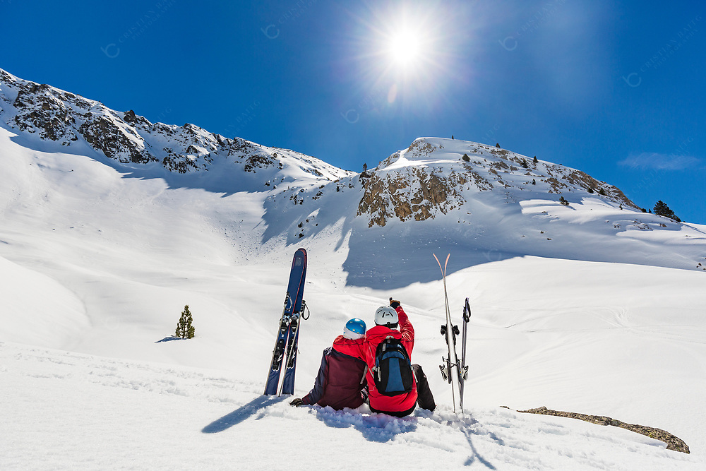 Man and woman together during backcountry skiing.