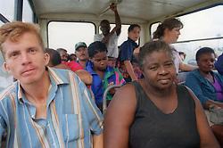 Passengers travelling in bus on the motorway in Cuba,